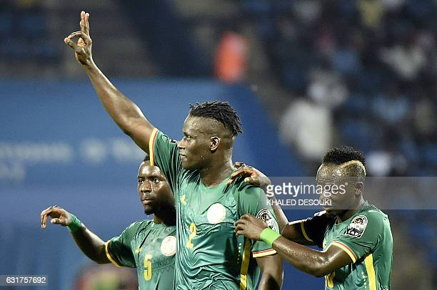 Senegal's defender Kara Mbodji celebrates with Senegal's midfielder Idrissa Gana Gueye and Senegal's forward Sadio Mane after scoring a goal during...