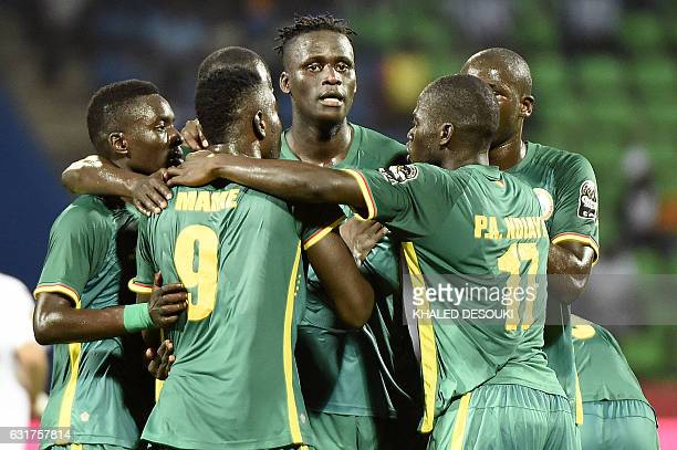 Senegal's defender Kara Mbodji celebrates with teammates after scoring a goal during the 2017 Africa Cup of Nations group B football match between...