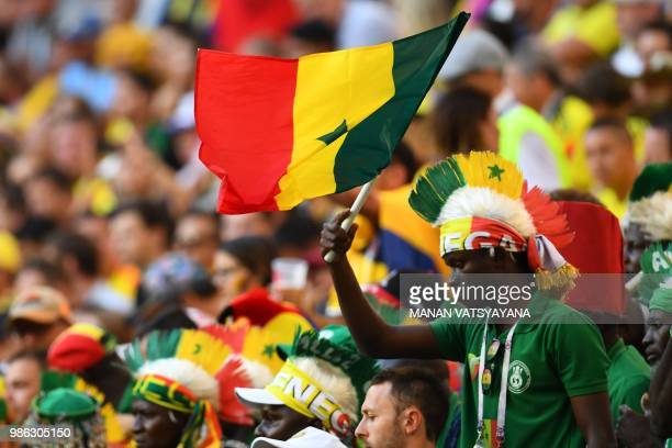 A Senegal's fan cheers during the Russia 2018 World Cup Group H football match between Senegal and Colombia at the Samara Arena in Samara on June 28...