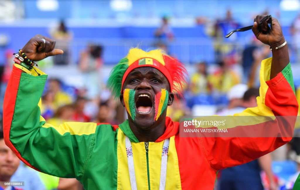 A Senegal's fan cheers prior to the Russia 2018 World Cup Group H football match between Senegal and Colombia at the Samara Arena in Samara on June 28, 2018. (Photo by Manan VATSYAYANA / AFP) / RESTRICTED