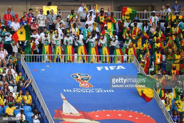 Senegal's fans cheer during the Russia 2018 World Cup Group H football match between Senegal and Colombia at the Samara Arena in Samara on June 28...