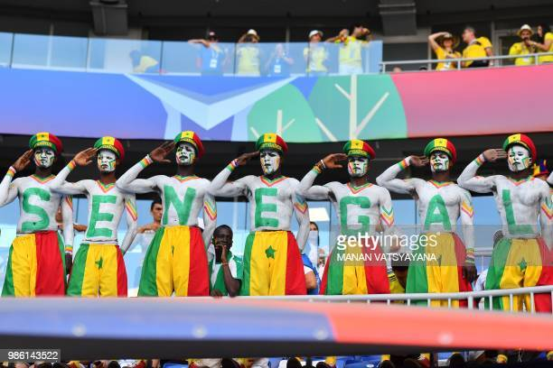 Senegal's fans pose as they attend the Russia 2018 World Cup Group H football match between Senegal and Colombia at the Samara Arena in Samara on...