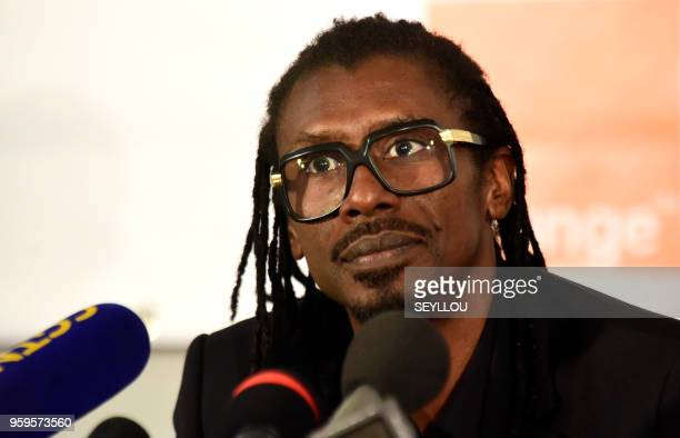 Senegal's football coach Aliou Cisse looks on at a hotel in Dakar on May 17 during the announcement of squad members ahead of the forthcoming 2018...