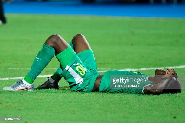 TOPSHOT Senegal's forward Ismaila Sarr reacts to the defeat during the 2019 Africa Cup of Nations Final football match between Senegal and Algeria at...