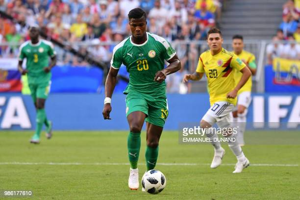 Senegal's forward Keita Balde runs with the ball during the Russia 2018 World Cup Group H football match between Senegal and Colombia at the Samara...