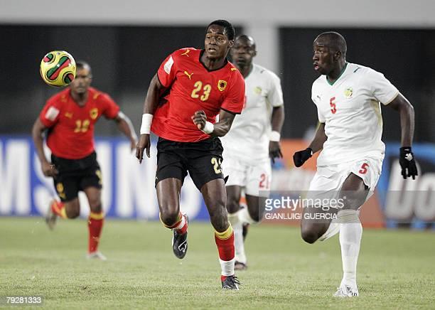 TEAM Senegal's forward Maleus Alberto 'Manucho' breaks past Angola's defender Souleymane Diawara 27 January 2008 during the 2008 African Cup of...