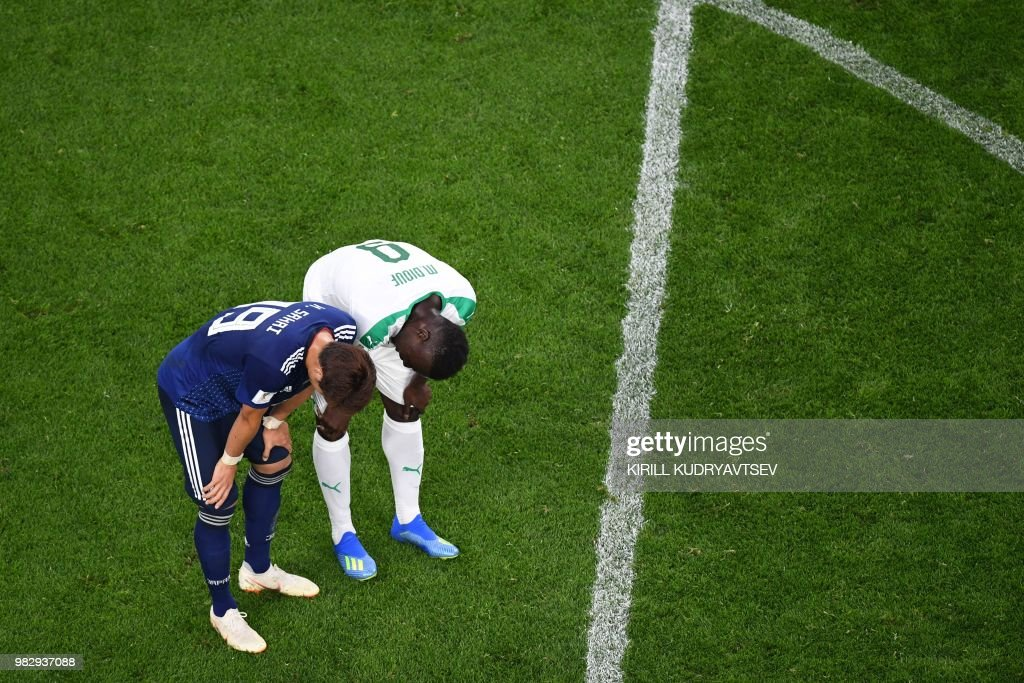 TOPSHOT - Senegal's forward Mame Biram Diouf (R) and Japan's defender Hiroki Sakai talk after the Russia 2018 World Cup Group H football match between Japan and Senegal at the Ekaterinburg Arena in Ekaterinburg on June 24, 2018. (Photo by Kirill KUDRYAVTSEV / AFP) / RESTRICTED