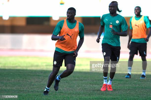 Senegal's forward Mbaye Diagne attends a training session of the Senegal national football team on the eve of their friendly match with Mali at the...