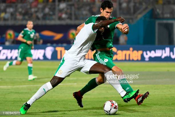 Senegal's forward M'baye Diagne fights for the ball with Algeria's defender Aissa Mandi during the 2019 Africa Cup of Nations football match between...