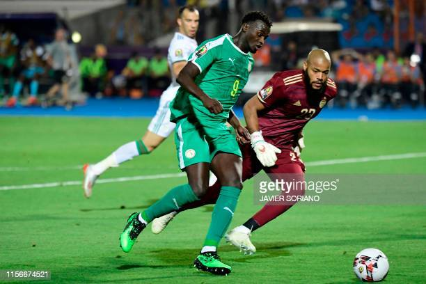 Senegal's forward M'baye Diagne tries to shoot past Algeria's goalkeeper Rais M'Bolhi during the 2019 Africa Cup of Nations Final football match...