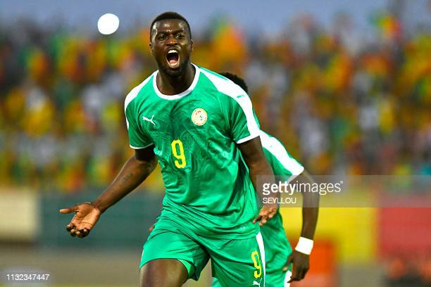 Senegal's forward Mbaye Hamady Niang celebrates after scoring during the 2019 African Cup of Nations Group A qualification football match between...