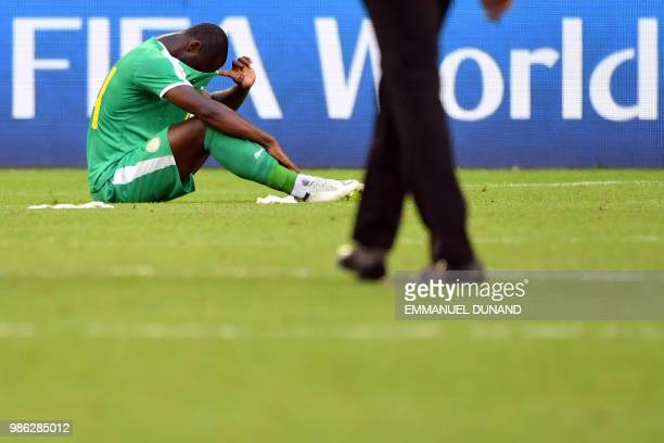 TOPSHOT Senegal's forward Moussa Konate reacts at the end of the Russia 2018 World Cup Group H football match between Senegal and Colombia at the...