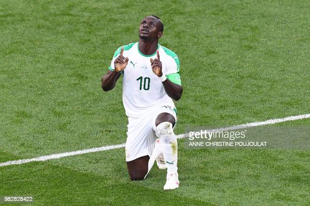 TOPSHOT Senegal's forward Sadio Mane celebrates a goal during the Russia 2018 World Cup Group H football match between Japan and Senegal at the...