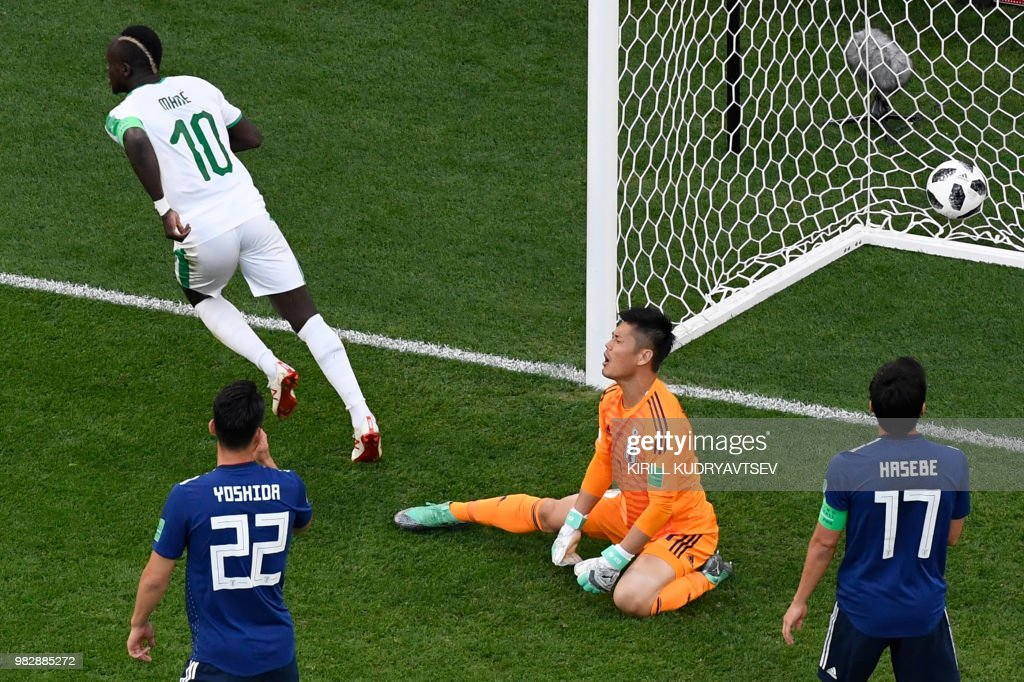 TOPSHOT - Senegal's forward Sadio Mane (10) celebrates after scoring the opening goal during the Russia 2018 World Cup Group H football match between Japan and Senegal at the Ekaterinburg Arena in Ekaterinburg on June 24, 2018. (Photo by Kirill KUDRYAVTSEV / AFP) / RESTRICTED