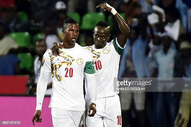 Senegal's forward Sadio Mane celebrates with Senegal's forward Keita after scoring a goal during the 2017 Africa Cup of Nations group B football...