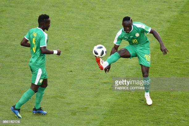 Senegal's forward Sadio Mane controls the ball next to Senegal's midfielder Idrissa Gana Gueye during the Russia 2018 World Cup Group H football...