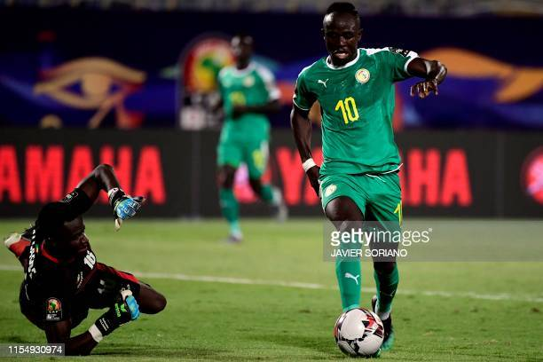 Senegal's forward Sadio Mane dribbles past Benin's goalkeeper Saturnin Allagbe during the 2019 Africa Cup of Nations quarter final football match...