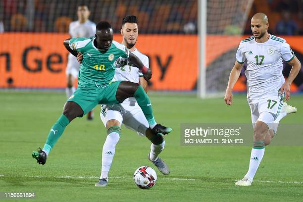 Senegal's forward Sadio Mane fights for the ball with Algeria's defender Ramy Bensebaini during the 2019 Africa Cup of Nations Final football match...