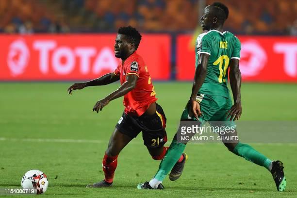 Senegal's forward Sadio Mane fouls Uganda's midfielder Allan Kyambadde during the 2019 Africa Cup of Nations Round of 16 football match between...