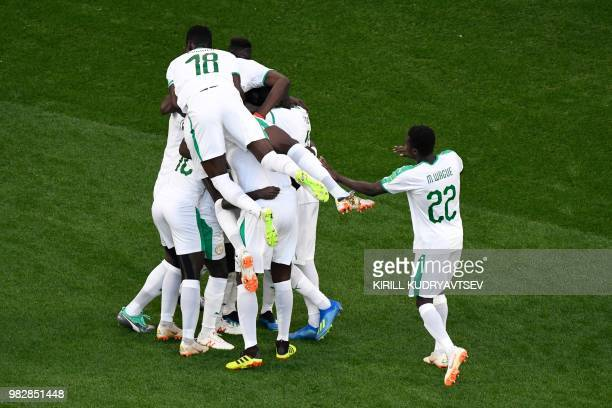 Senegal's forward Sadio Mane is congratulated by teammates after scoring the opening goal during the Russia 2018 World Cup Group H football match...