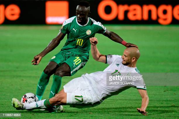 TOPSHOT Senegal's forward Sadio Mane is tackled by Algeria's midfielder Adlene Guedioura during the 2019 Africa Cup of Nations Final football match...