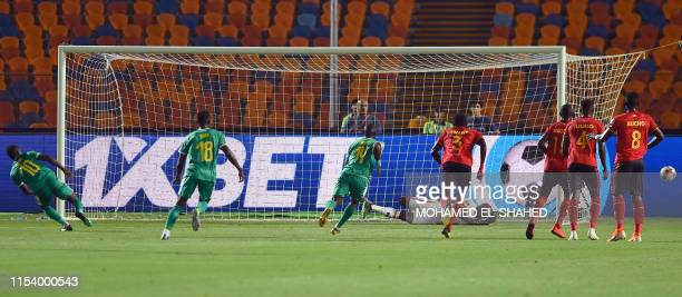 Senegal's forward Sadio Mane misses a penalty kick during the 2019 Africa Cup of Nations Round of 16 football match between Uganda and Senegal at the...