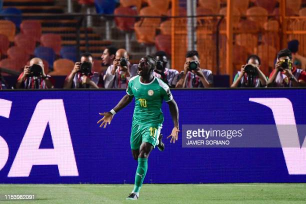 Senegal's forward Sadio Mane reacts after scoring a goal during the 2019 Africa Cup of Nations Round of 16 football match between Uganda and Senegal...