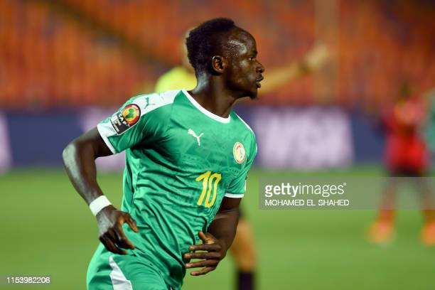 Senegal's forward Sadio Mane runs after scoring a goal during the 2019 Africa Cup of Nations Round of 16 football match between Uganda and Senegal at...