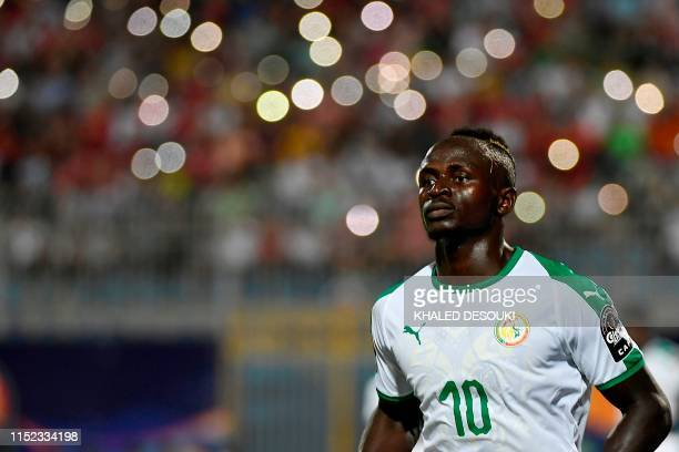 Senegal's forward Sadio Mane runs during the 2019 Africa Cup of Nations football match between Senegal and Algeria at the June 30 Stadium in Cairo on...