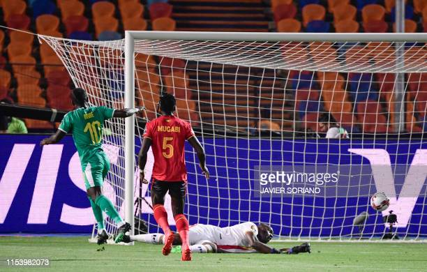 Senegal's forward Sadio Mane scores a goal during the 2019 Africa Cup of Nations Round of 16 football match between Uganda and Senegal at the Cairo...
