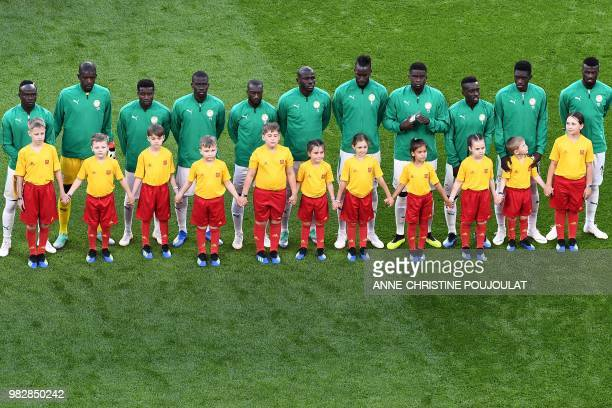Senegal's forward Sadio Mane Senegal's goalkeeper Khadim N'Diaye Senegal's defender Moussa Wague Senegal's midfielder Papa Alioune Ndiaye Senegal's...