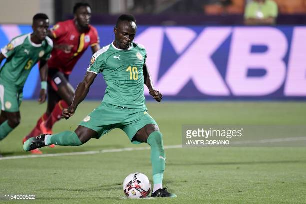 Senegal's forward Sadio Mane shoots a penalty kick during the 2019 Africa Cup of Nations Round of 16 football match between Uganda and Senegal at the...