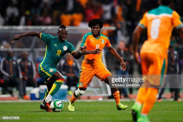 Senegal's forward Sadio Mane vies with Ivory Coast's midfielder Franck Kessie during the friendly football match Ivory Coast vs Senegal on March 27...