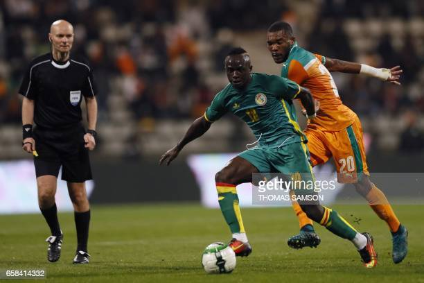 Senegal's forward Sadio Mane vies with Ivory Coast's midfielder Serey Die Geoffroy during the friendly football match Ivory Coast vs Senegal on March...