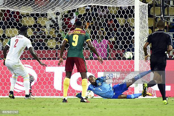 Senegal's goalkeeper Abdoulaye Diallo blocks a shot on goal by Cameroon's forward Jacques Zoua during the 2017 Africa Cup of Nations quarterfinal...