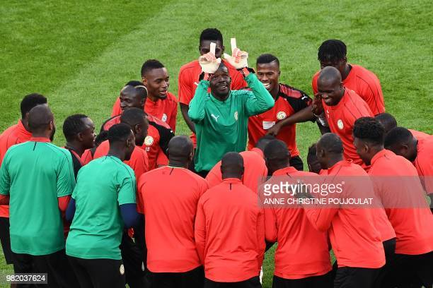 Senegal's goalkeeper Abdoulaye Diallo gestures during a training session on June 23 2018 at Ekaterinburg Arena on the eve of the team's third match...
