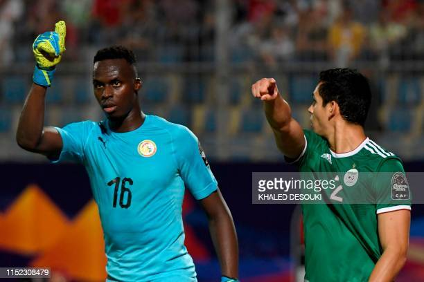 Senegal's goalkeeper Edouard Mendy and Algeria's defender Aissa Mandi gesture during the 2019 Africa Cup of Nations football match between Senegal...