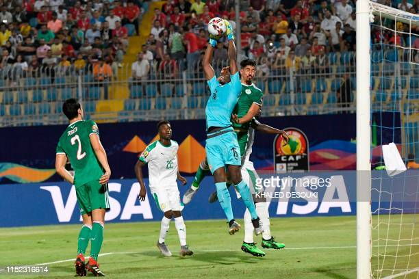 Senegal's goalkeeper Edouard Mendy catches the ball over Algeria's forward Baghdad Bounedjah during the 2019 Africa Cup of Nations football match...