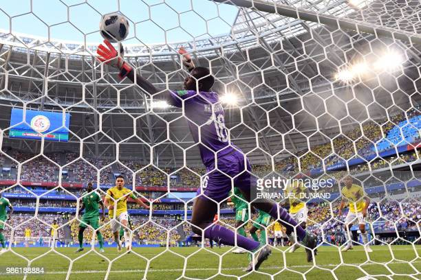 Senegal's goalkeeper Khadim N'Diaye fails to stop a goal during the Russia 2018 World Cup Group H football match between Senegal and Colombia at the...
