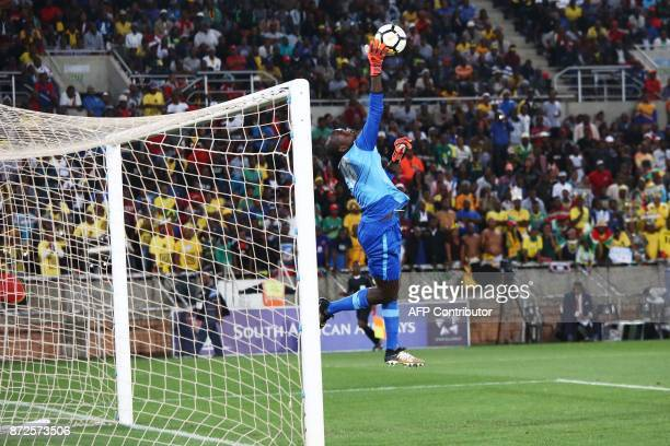 Senegal's goalkeeper Khadim Ndiaye jumps for the ball during the FIFA 2018 World Cup Africa Group D qualifying football match between South Africa...