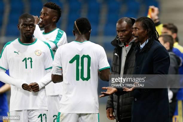 Senegal's headcoach Aliou Cisse talks to Senegal's Pape Alioune Ndiaye and Senegal's Sadio Mane during A friendly football match between Senegal and...