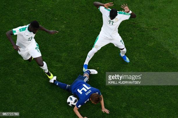 Senegal's midfielder Alfred N'Diaye and Senegal's midfielder Papa Alioune Ndiaye vies with Japan's midfielder Takashi Inui during the Russia 2018...
