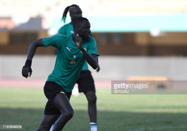 Senegal's midfielder Cheikhou Kouyate attends a training session of the Senegal national football team on the eve of their friendly match with Mali...