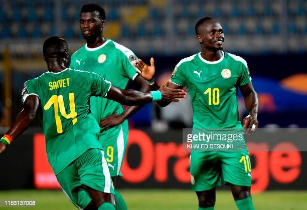 Senegal's midfielder Henri Saivet shakes hands with Senegal's forward Sadio Mane during the 2019 Africa Cup of Nations Group C football match between...
