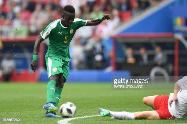 Senegal's midfielder Idrissa Gana Gueye prepares to shoot and score the opening goal during the Russia 2018 World Cup Group H football match between...