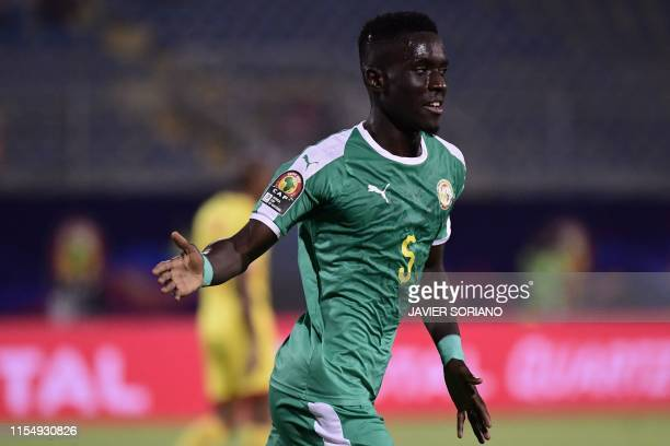 Senegal's midfielder Idrissa Gueye celebrates after scoring during the 2019 Africa Cup of Nations quarter final football match between Senegal and...