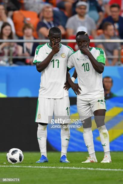 Senegal's midfielder Papa Alioune Ndiaye and Senegal's forward Sadio Mane speak together during the Russia 2018 World Cup Group H football match...