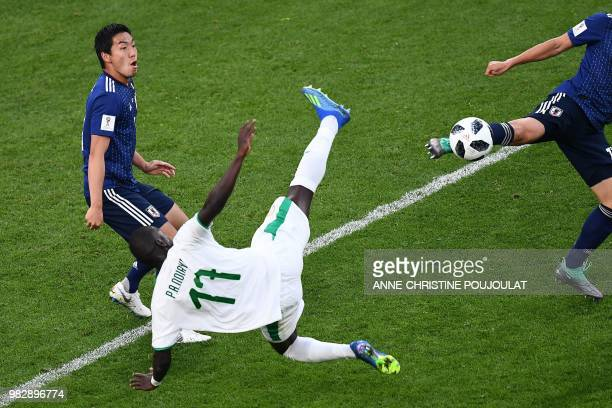 Senegal's midfielder Papa Alioune Ndiaye falls during the Russia 2018 World Cup Group H football match between Japan and Senegal at the Ekaterinburg...