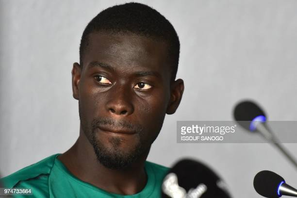 Senegal's midfielder Papa Alioune Ndiaye reacts as he speaks during a press conference on June 14 2018 in Kaluga during the Russia 2018 World Cup...