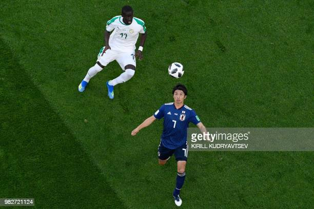 Senegal's midfielder Papa Alioune Ndiaye vies with Japan's midfielder Gaku Shibasaki during the Russia 2018 World Cup Group H football match between...